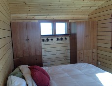 Knotty Pine Cladding in Cabin Bedroom