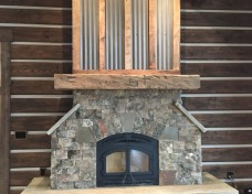 Montana Moss Rock with Frontier Stone Hearth and Reclaimed Mantle